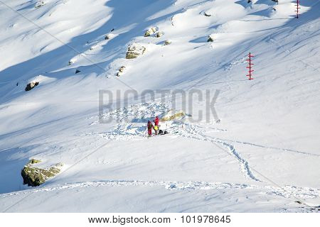 People getting ready for winter mountain route. Traces and signposts in the snow
