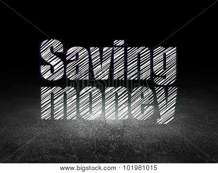 Business concept: Saving Money in grunge dark room