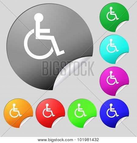 Disabled Sign Icon. Human On Wheelchair Symbol. Handicapped Invalid Sign. Set Of Eight Multi Colored