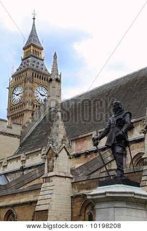 Statue of Oliver Cromwell at Westminster and Big Ben Clock Tower in London