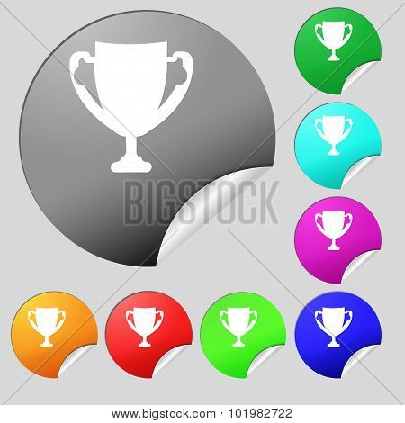 Winner Cup Sign Icon. Awarding Of Winners Symbol. Trophy. Set Of Eight Multi Colored Round Buttons,