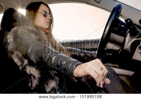 Confident female racer drives car
