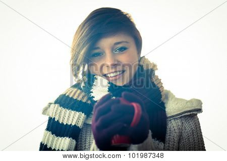 Attractive woman wearing warm clothes in studio