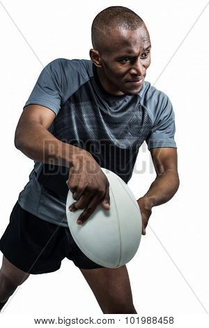 Confident athlete throwing rugby ball over white background