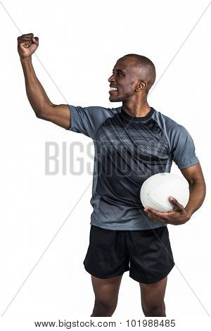 Sportsman with clenched fist after victory standing over white background