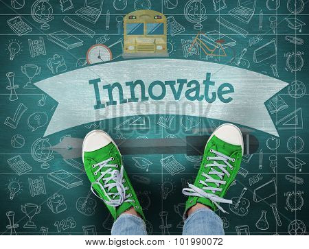 The word innovate and casual shoes against green chalkboard