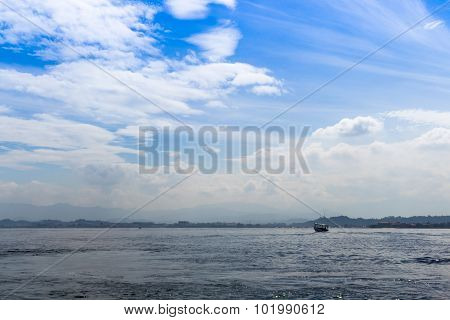 Blue Sea  And Blue Sky With Clouds