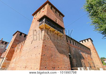 VERONA, ITALY - SEPTEMBER 2014 : The famous and old brick Castle Fortress (Castelvecchio) in Verona, northern Italy on September 14, 2014. Castelvecchio was built in 1354 by the Scaliger Cangrande II