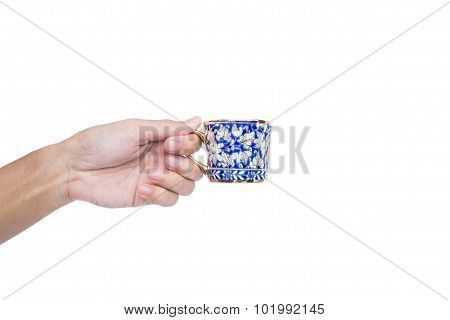 Hand holding classic luxury porcelain cup, isolated on white background