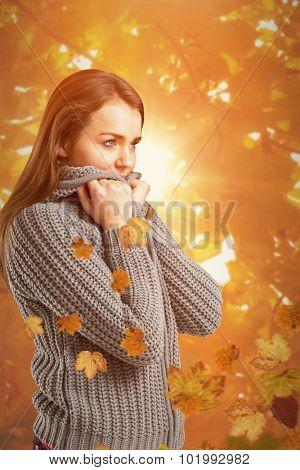 Pretty girl in winter jumper against autumn scene