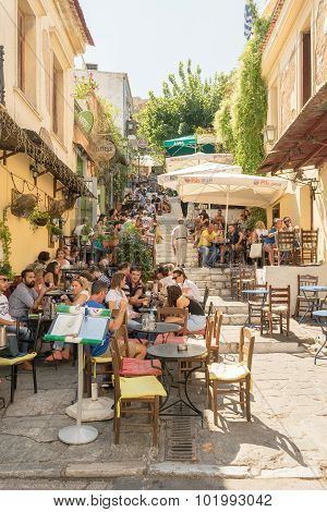 Athens, Greece 13 September 2015. Tourists and local people at famous Plaka street drinking coffee