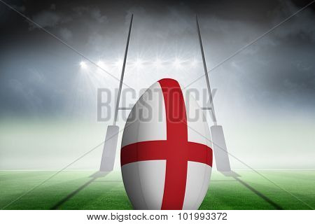 England flag rugby ball against rugby pitch