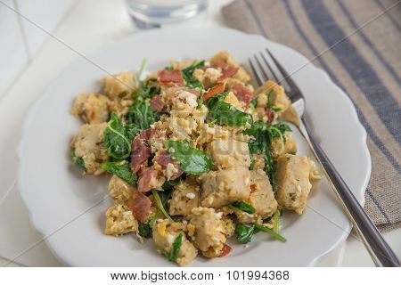 Roasted dumplings with egg and salad
