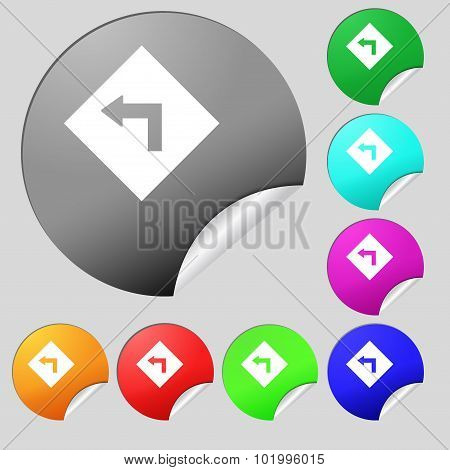 Road Sign Warning Of Dangerous Left Curve Icon Sign. Set Of Eight Multi Colored Round Buttons, Stick