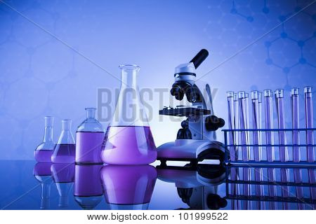 Laboratory work place with microscope and glassware