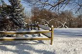 stock photo of split rail fence  - backyard farm split rail fence in snow - JPG