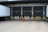 stock photo of loading dock  - distribution warehouse receiving and shipping loading dock bays - JPG