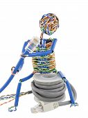 image of utp  - The stylised little man made of a computer cable sits on spool UTP and looks on blue patch cable - JPG