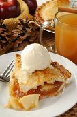 picture of cider apples  - A festive display of fresh apple pie with ice cream and hot cider - JPG