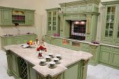 image of green wall  - luxury green kitchen caps on marble table - JPG