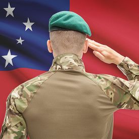 image of samoa  - Soldier in hat facing national flag series  - JPG