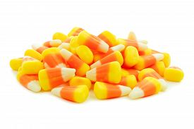 pic of sweet-corn  - Pile of Halloween candy corn over a white background - JPG