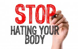 pic of hate  - Hand with marker writing the word Stop Hating Your Body - JPG