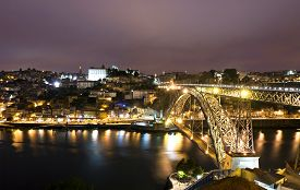 picture of dom  - Night view of Dom Luis Bridge over Duoro river in City of Porto Portugal - JPG