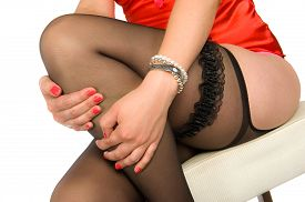 stock photo of sluts  - A sexy woman with stockings and a garter sitting on a chair - JPG