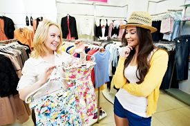 picture of apparel  - Two Young women with apparel shirt or blouse during garments clothing shopping at store - JPG