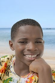 stock photo of ten years old  - Lovely boy smiling at the beach - JPG