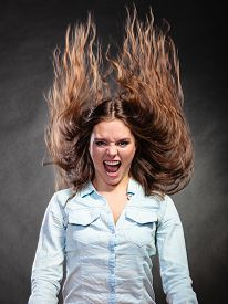 picture of hair motion  - Happy and ecstatic woman having fun - JPG