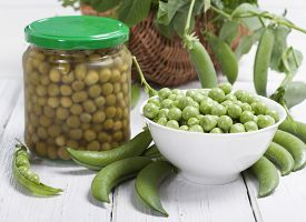 image of pea  - Fresh green peas in a white bowl canned peas in a glass jar and some pea pods on a white table - JPG