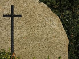 picture of tombstone  - Black cross engraved on granite background  - JPG