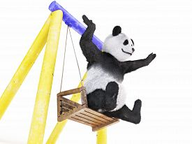 picture of seesaw  - paws spread wide to sides cheerful character panda sitting on swing  - JPG