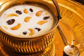 picture of pal  - Pudding Pal Payasam Kheer Indian food garnished with cashew and raisin Side View - JPG