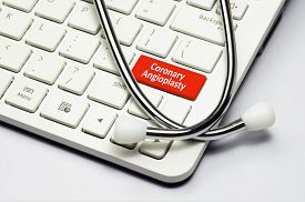 foto of stent  - Coronary Angioplasty text stethoscope lying down on the cumputer keyboard - JPG