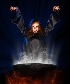 picture of cauldron  - Young witch girl with cauldron - JPG