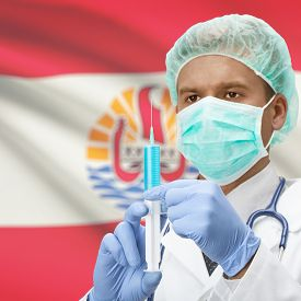 stock photo of french polynesia  - Doctor with syringe in hands and flag on background series  - JPG