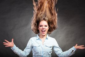 stock photo of hair motion  - Happy and ecstatic woman having fun - JPG