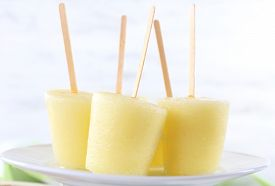 image of lolli  - Melon ice lolly on table on light blurred background - JPG