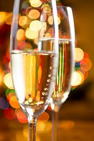 picture of champagne color  - Macro abstract photo of champagne in crystal glasses against colorful lights - JPG