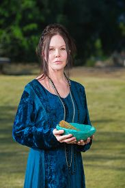 picture of wicca  - Serious Wicca priestess with blue bowl sage incense - JPG