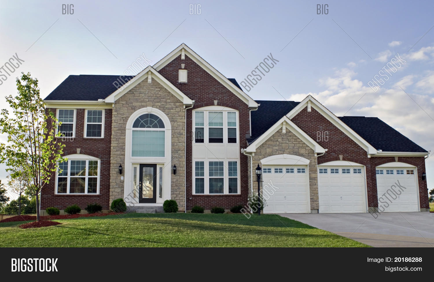 Three car garage luxury home image photo bigstock for 3 car garage homes