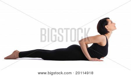 woman back bends yoga - baby cobra pose isolated