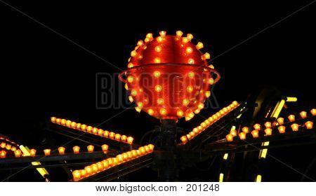 Orange Carnival Lights Against Jet Black Sky