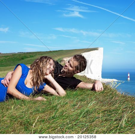 Happy Couple On The Edge Of A Cliff