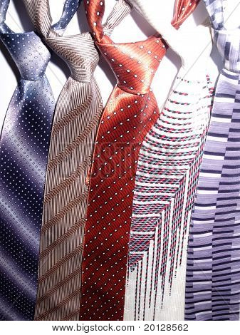 a group of ties in white background
