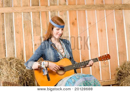 Young Hippie Woman Play Guitar In Barn
