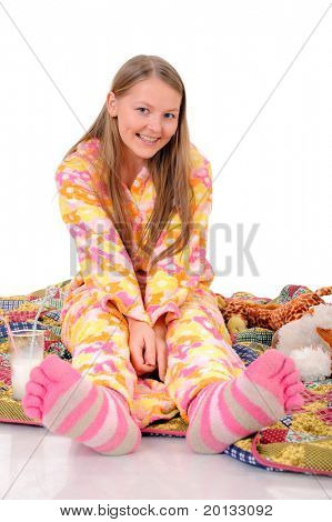 pretty girl with pink sox sitting on the blanket